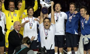 Victorious England skipper Robbie Williams lifts the Soccer Aid trophy.